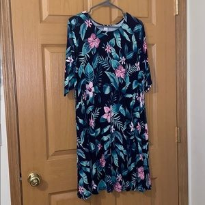 Navy blue dress with green leaves
